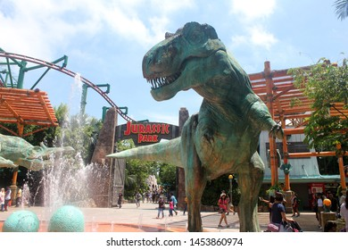 Singapore City, Singapore - Nov 4, 2017 : Large dinosaur statue in front of jurassic park at Universal Studios Singapore.Big dinosaur figurehead in front of jurassic park at amusement park.