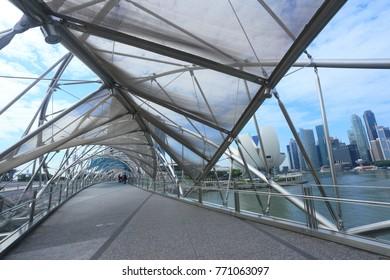SINGAPORE CITY, SINGAPORE - NOVEMBER 22, 2017: Helix bridge travel landmark in Singapore and  is a pedestrian bridge linking Marina Centre with Marina South in the Marina Bay area in Singapore.