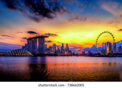 SINGAPORE CITY, SINGAPORE: OCT 15,2017: Singapore Skyline. Singapore`s business district, marina bay sand and the garden by the bay on sunset.