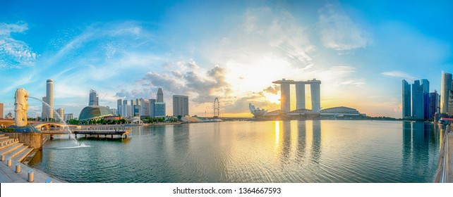 SINGAPORE CITY, SINGAPORE: OCT 29, 2017: Vibrant panorama of Singapore city skyline at business modern downtown building area in sunrise with cloud and sun light and reflection  architecture on water