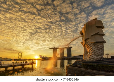 SINGAPORE CITY, SINGAPORE: OCT 31,2017: Singapore Skyline. Singapore`s business district, marina bay sand and the garden by the bay on sunrise