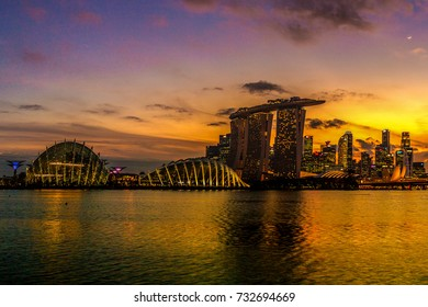 SINGAPORE CITY, SINGAPORE: OCT 5,2017: Singapore Skyline. Singapore`s business district, marina bay sand and the garden by the bay on sunset.