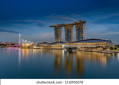 SINGAPORE CITY, SINGAPORE - OCTOBER 08, 2016: The Marina Bay complex with modern hotel, retail outlets and restaurants.  There is a regular laser show each evening from the roof of the hotel.