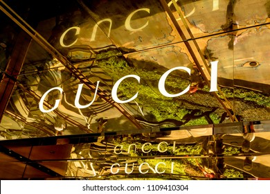 SINGAPORE CITY, SINGAPORE - OCTOBER 09, 2016: Striking signage at  a Gucci store in Singapore.  Gucci is an Italian luxury brand of fashion and leather goods with stores thought the world.