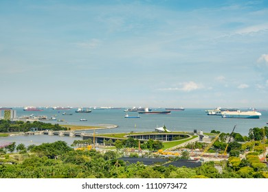 SINGAPORE CITY, SINGAPORE - OCTOBER 09, 2016:  Singapore Marina Barrage with cargo ships waiting to enter one of the busiest ports in the world, Singapore.