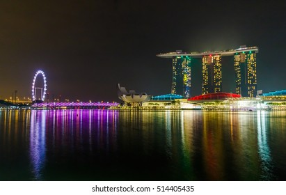 SINGAPORE CITY, SINGAPORE - OCTOBER 28, 2016: Marina Bay Sands at night during Light and Water Show 'Wonder Full' . It opened on 27 April 2010. Singapore on October 28, 2016