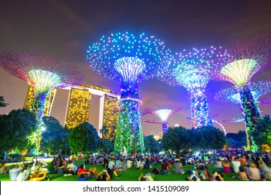 Singapore City, Singapore - October 9, 2016 : Super trees in gardens by the bay and marina bay in twilight