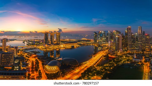 Singapore city with office building, hotel and harbor in morning sunrise time. Singapore city