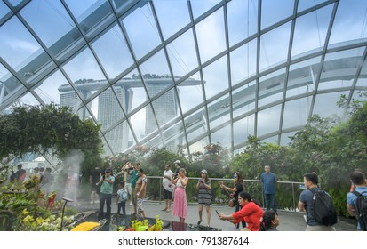 SINGAPORE CITY, SINGAPORE,November 11,2017: Inside of the Cloud Forest Dome, upper floor with many tourist- Garden by the Bay.
