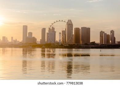 Singapore city skyline and Singapore Flyer at Marina Bay cityscape by night