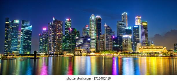 Singapore city skyline panorama at night