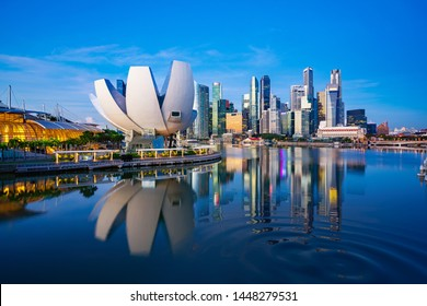 Singapore city and sunrise sky in harbour side view of hotel windows