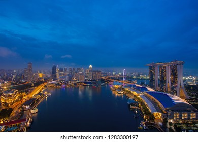 Singapore cityscape at dusk. Landscape of Singapore business building around Marina bay. Modern high building in business district area at twilight.