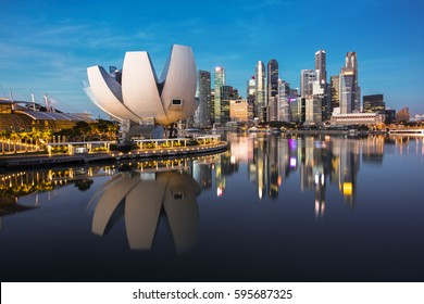 Singapore cityscape at dusk. Landscape of Singapore business building around Marina bay with shadow reflection. Modern high building in business district area at twilight.