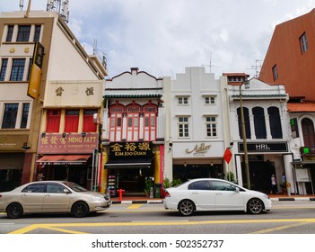 Singapore - Dec 14, 2015. Many cars parking on street in Chinatown, Singapore.