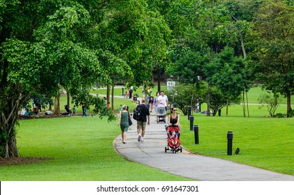 Singapore - Dec 14, 2015. People walking at botanic garden in Singapore. Singapore, referred to as the Lion City, the Garden City, is a sovereign city-state in Southeast Asia.