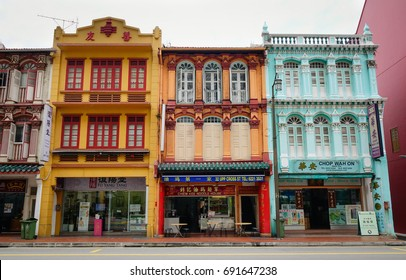 Singapore - Dec 15, 2015. Old buildings located on main street in Chinatown, Singapore. Chinatown is a bustling mix of old and new, filled with traditional shops and night markets.