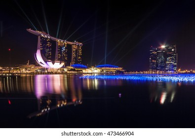 SINGAPORE - DEC 25 2012: The Marina Bay Sands Resort Hotel. Beautiful laser show at the marina bay waterfront in singapore