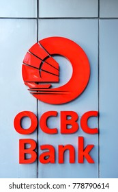 SINGAPORE - DECEMBER 1, 2017: OCBC Bank logo sign in Singapore Orchard Road. OCBC oversea Chinese Banking Corporation is a financial services organisation based in Singapore & offices in 15 countries.