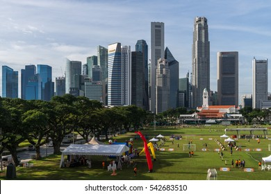 Singapore - December 10, 2016: Morning view over the lively Padang Square to the downtown core. This part forms the central business, the heart of the singaporean economy.