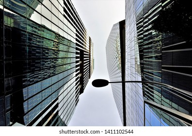 Singapore - December 12 2018: Perspective view of modern glass and steel façade of futuristic office skyscrapers in Singapore's Business District