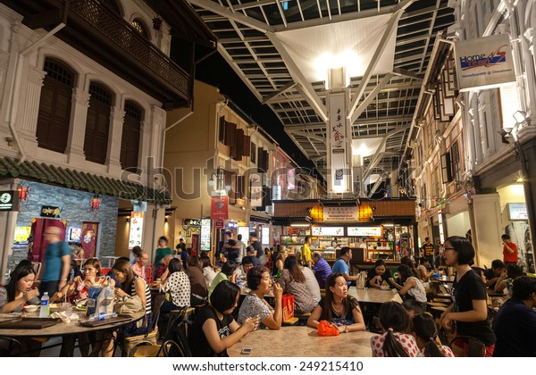 SINGAPORE - DECEMBER 12: Diners eating on Smith Street in Chinatown December 12, 2014. This outdoor Chinatown Food Street features food stalls offering authentic local Singapore dishes.