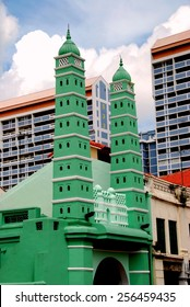 Singapore - December 14, 2007:  Twin minarets flank the street facade of the 1826 Jamae Chulia Mosque on South Bridge Road in Chinatown