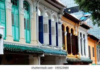 SINGAPORE - December 16, 2007:  A descending row of  colourful early 20th century restored Peranakan-built shop houses on historic Emerald Hill