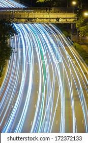 Singapore, Singapore - December, 21: Car light trails on highway in Singapore taken on December 21, 2013