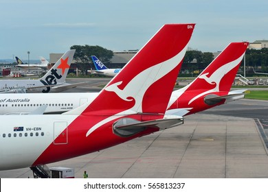 SINGAPORE - DECEMBER 23: Tails of Jetstar International, Qantas and ANA Cargo aircraft at Changi Airport on December 23, 2016 in Singapore