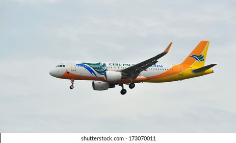 SINGAPORE - DECEMBER 25:  Cebu Pacific Airbus A320 with new sharklets landing at Changi Airport on December 25, 2013 in Singapore