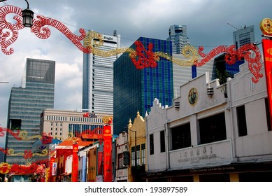 SINGAPORE - December 28, 2007:  Chinese Lunar New Year decorations span South Bridge Street in the heart of Chinatown with modern city business district corporate towers in the background