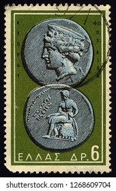 SINGAPORE - DECEMBER 28, 2018: A stamp printed in the Greece shows Aphrodite and Apollo, Ancient Greek Coin, circa 1959