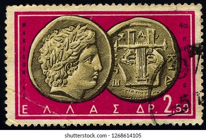 "SINGAPORE - DECEMBER 28, 2018: A stamp printed in Greece from the ""Ancient Greek Coins"" issue shows a coin from Chalcidice, Macedonia 4th century B.C. (Apollo and lyre), circa 1959"