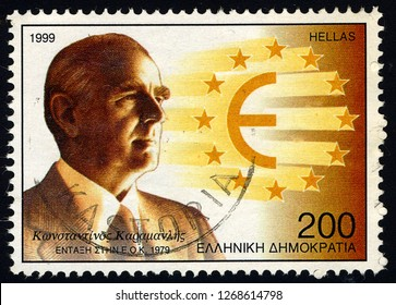 SINGAPORE - DECEMBER 28, 2018: A stamp printed in Greece shows Konstantinos Karamanlis - Greece's Accession to the EEC, circa 1999.