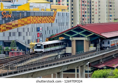 SINGAPORE  - DECEMBER 29, 2018: Singapore mass rapid train (MRT) travels on the track. The MRT has 106 stations and is the second-oldest metro system in Southeast Asia.