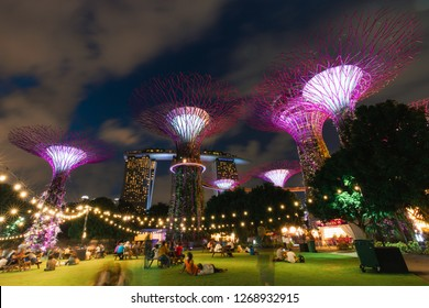 Singapore - December 4, 2018: People relaxing around Supertree Groove area at night.