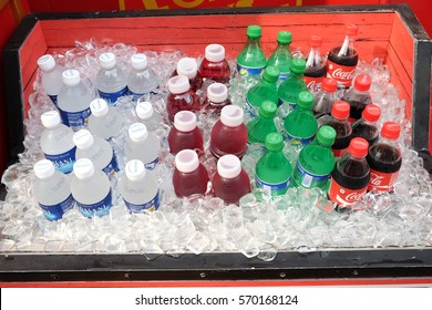Singapore - December 9, 2014: Coca-Cola, Sprite, Dasani and mineral water bottles on ice bucket. The four drinks are the best sold refreshing drinks in Singapore.