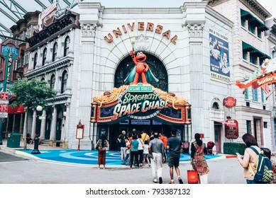 SINGAPORE - DEMCEMBER 20, 2017: Universal Studios Singapore on Sentosa Island, Singapore. Tourists walking to the Universal Studios, Singapore for playing the funny machines.