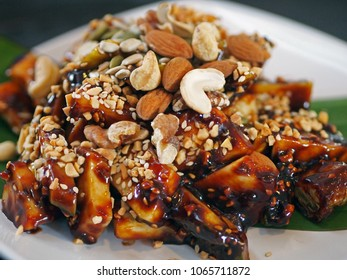 Singapore Dessert : Nutty Rojak , the freshest tasting salad – crunchy fruit and vegetable in a sweetly sticky, slightly sour dressing, sprinkled with roasted peanuts and cashew nuts.