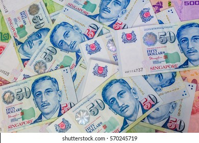 Singapore Dollar, Banknote Singapore and Thai Baht in the Corner, The Singapore dollar is the official currency of Singapore