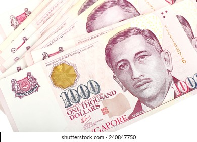 Singapore Dollars on a white background.