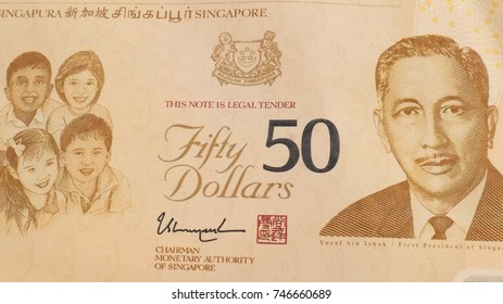 SIngapore Dollars on the Wooden Table