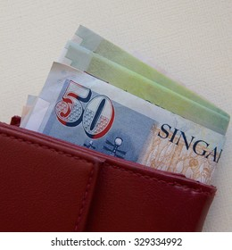 Singapore Dollars in a Red Purse