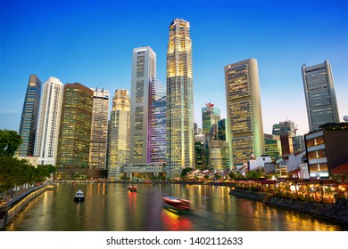 Singapore downtown skyline with river at dusk
