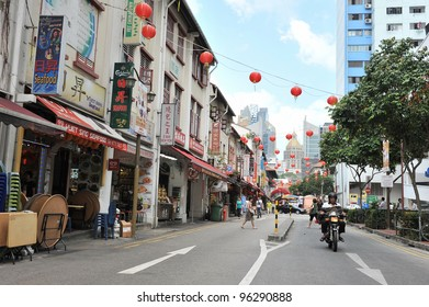 SINGAPORE - FEB 11: Street scene in Singapore's Chinatown as the city state welcomes in Chinese New Year on Feb 11, 2012 in Singapore. The city's ethnic Chinese began settling in Chinatown circa 1820.