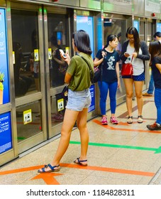 SINGAPORE - FEB 18, 2017: Passengers in Singapore Mass Rapid Transit (MRT) train. The MRT has 102 stations and is the second-oldest metro system in Southeast Asia