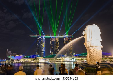SINGAPORE -FEB 20, 2016 : Singapore skyline of marina bay in Singapore at night and laser show at marina bay sands hotel