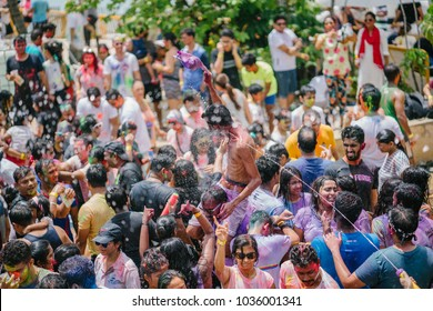 Singapore, Feb 2018: Holi celebration in Wave House, Sentosa. Holi is the festival of colors to celebrate a bountiful harvest. Indians and other nationalities smear color on one another and dance.