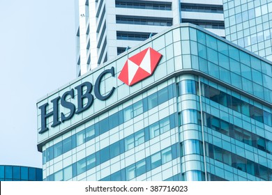 "SINGAPORE - FEB 21, 2016 : Logo of ""HSBC"" on top of building and business building background"